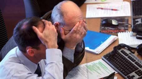 Dow Jones в четверг скатился до 5-летнего минимума. Фото: AFP