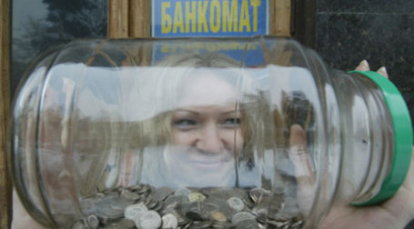 Деньги в банке. Фото: PhotoXPress