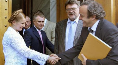 Юлия Тимошенко и президент УЕФА Мишель Платини. Фото: AFP