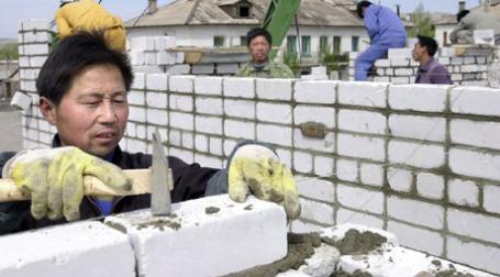 Китайские строители. Фото: ИТАР-ТАСС