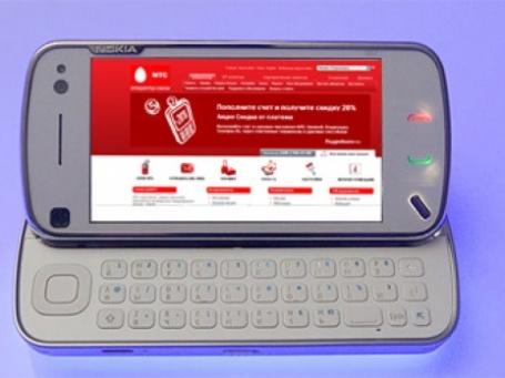 Телефон Nokia N97 с открытым сайтом компании МТС. Фото и коллаж: Александр Беленький/BFM.ru