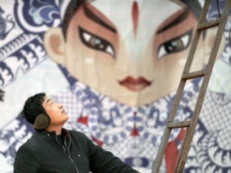 Монтаж декораций для празднования Нового Года в Китае. Фото: AFP