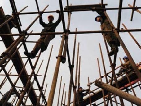 Китайские строители. Фото: AFP