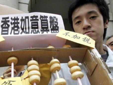 Китаец и счеты. Фото: AFP