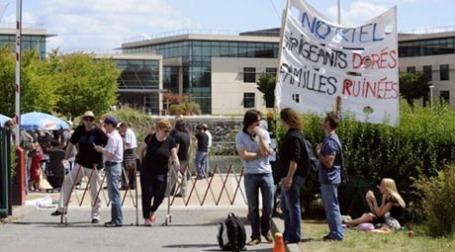 Рабочие завода компании Nortel провели забастовку. Фото: AFP