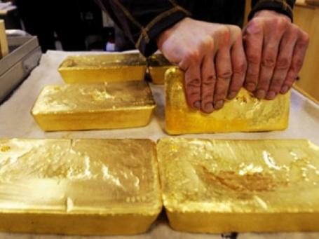Цена на золото снова выросла, обновив исторический максимум. Фото: AFP