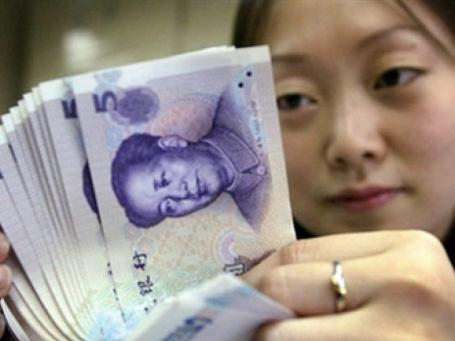 Китай намекает на укрепление юаня. Фото: AFP