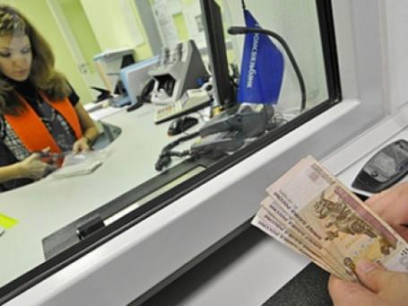 В России второй день продолжается падение фондовых индексов, а рубль рухнул по отношению к доллару на 94 копейки — до 28,81 рубля. Фото: РИА Новости