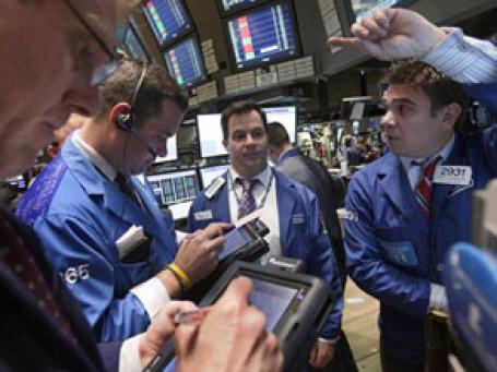 Участники рынка спорят о том, отработал ли рынок весь избыточный рост цен и может ли вернуться к стабильному подъему. Фото: AP