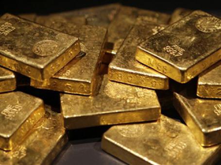 Глобальные инвесторы начали искать «тихую гавань» в золотых инвестициях. Фото: AP