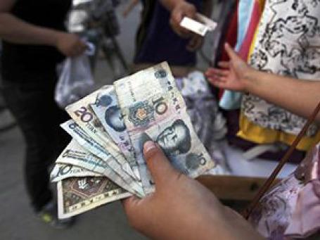 Курс юаня к доллару повысился до пятилетнего максимума. Фото: AP