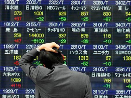 Главными аутсайдерами торгов в Японии оказались акции страховых компаний, на «плечи» которых и ляжет львиная часть расходов по восстановлению. Фото: AP