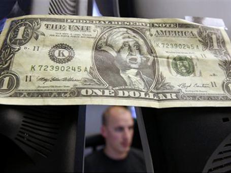 Может ли биткойн заменить доллар? Сейчас — едва ли. Фото: AP