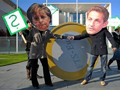 Активисты организации Oxfam, переодетые в Ангелу Меркель и Николя Саркози. Фото: AP