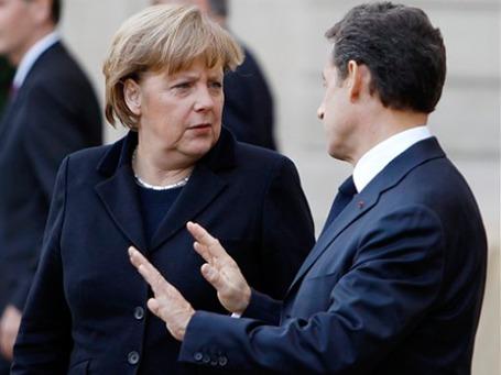Меркель и Саркози представят в Брюсселе новый план по спасению евро. Фото: AP