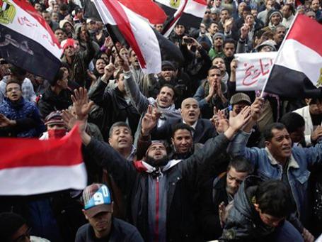 В Египте — первая годовщина «революции 25 января». Для одних этот день праздничный, для других — траурный. Фото: AP