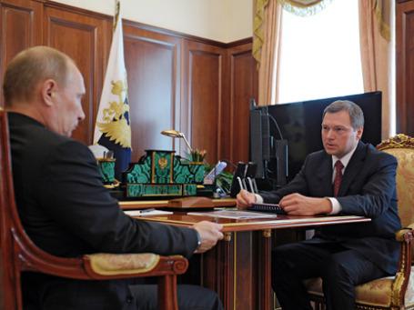 Владимир Путин и председатель правления ФСК ЕЭС Олег Бударгин на встрече в Кремле. Фото: РИА Новости