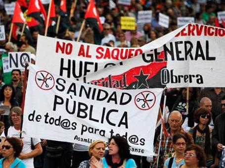 В Мадриде ежедневно устраивают с десяток акций протеста из-за политики бюджетной экономии. Фото: AP