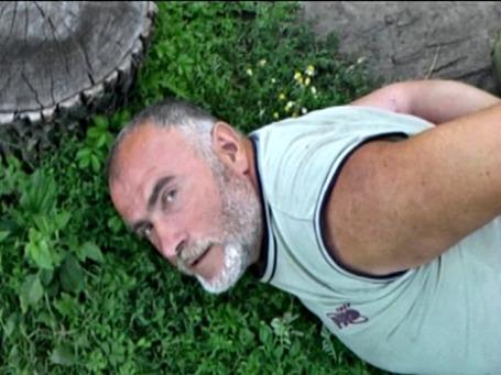 Сотрудник МВД Украины Алексей Пукач, обвиняемый в убийстве журналиста Георгия Гонгадзе, во время задержания в Житомирской области. Фото: ИТАР-ТАСС