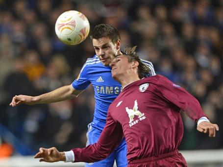 Игроки футбольных команд, лондонского «Челси» и казанского «Рубина», в четвертьфинальном матче Лиги Европы. Фото: Reuters