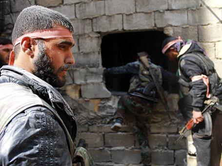 Бойцы сирийской армии в Алеппо, Сирия. Фото: Reuters