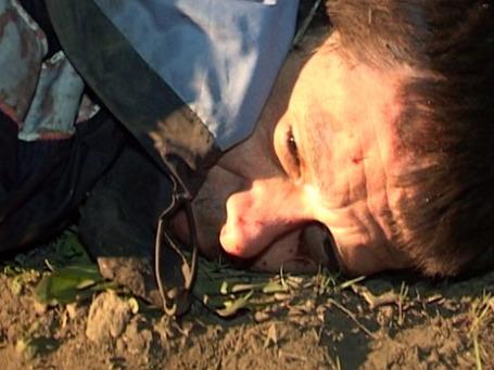Сергей Помазун, подозреваемый в стрельбе на Народном бульваре в Белгороде, в результате которой погибли шесть человек, во время задержания на железнодорожной станции. Фото: РИА Новости