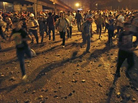 Столкновения между сторонниками и противниками Мухаммеда Мурси в Египте. Фото: Reuters