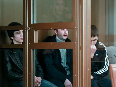 Ахмед Евлоев, Ислам Яндиев и Башир Хамхоев (слева направо), обвиняемые по делу о теракте в аэропорту «Домодедово». Фото: РИА Новости