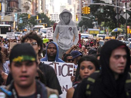 Участники акции на Таймс-сквер в Нью-Йорке. Фото: Reuters