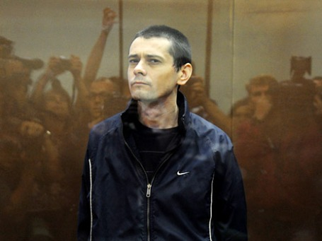 Сергей Помазун, обвиняемый в убийстве шести человек, на заседании Белгородского областного суда. Фото: РИА Новости