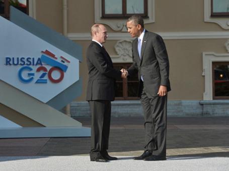 Президент России Владимир Путин (слева) и президент Соединенных Штатов Америки (США) Барак Обама на официальной церемонии встречи глав делегаций государств-участников «Группы двадцати». Фото: РИА Новоси