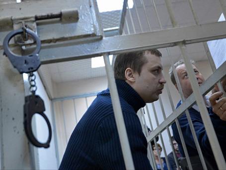 Михаил Косенко, обвиняемый по делу о беспорядках на Болотной площади в Москве, на судебном заседании в Замоскворецком суде 13 сентября 2013 года. Фото: РИА Новости