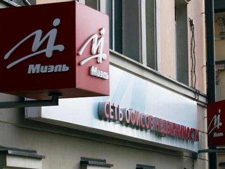 Вывеска на одном из офисов компании «Миэль-Недвижимость». Фото: РИА Новости