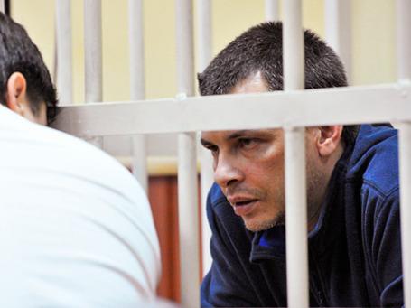 Алексей Кабанов, обвиняемый в убийстве супруги журналистки Ирины, во время предварительных слушаний в Головинском суде Москвы. 11 ноября 2013 г. Фото: РИА Новости