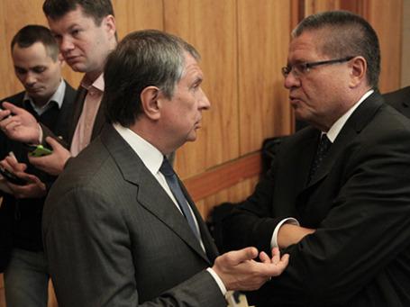 Министр экономического развития РФ Алексей Улюкаев и президент  «Роснефти» Игорь Сечин. Фото: PhotoXPress