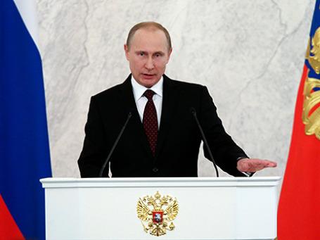 Президент России Владимир Путин во время оглашения ежегодного Послания Президента Российской Федерации Федеральному Собранию в Георгиевском зале Кремля. Фото: Reuters