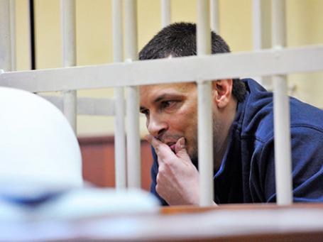 Алексей Кабанов, обвиняемый в убийстве супруги журналистки Ирины, во время предварительных слушаний в Головинском суде Москвы 11 ноября 2013 г. Фото: РИА Новости