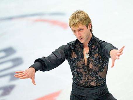 Евгений Плющенко выступает в произвольной программе мужского одиночного катания на чемпионате России по фигурному катанию в Сочи. Фото: РИА Новости