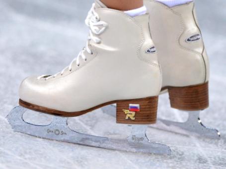 Спортсменка Татьяна Волосожар (Россия) во время выступления в короткой программе парного катания командных соревнований по фигурному катанию на XXII зимних Олимпийских играх в Сочи. Фото: РИА Новости
