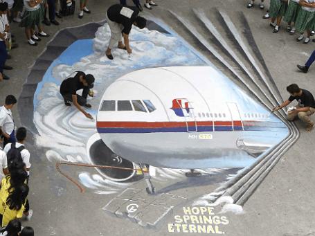 Акция поддержки родственников и близких пропавшего Boeing-777 компании Malaysia Airlines. Фото: Reuters.