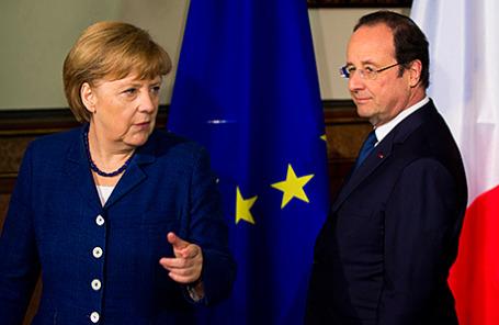Канцлер Германии Ангела Меркель и президент Франции Франcуа Олланд на переговорах в Штральзунде, Германия, 10 мая 2014.