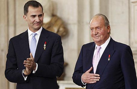 Хуан Карлос и его сын Фелипе (справа налево).