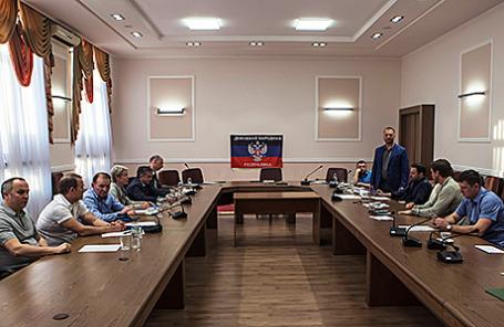 Трехсторонние переговоры по реализации мирного плана на востоке Украины в Донецке, 23 июня 2014.