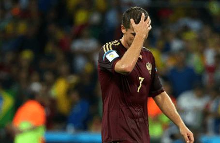 Игрок сборной России Игорь Денисов после матча чемпионата мира по футболу - 2014: Алжир - Россия.