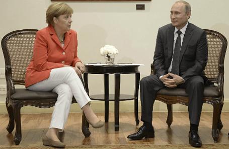 Канцлер Германии Ангела Меркель и президент России Владимир Путин на встрече в Рио-де-Жанейро