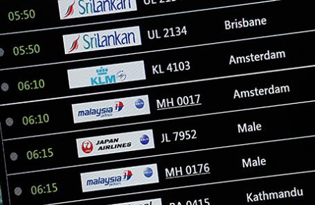 Табло с расписанием рейсов прибытия, в частности Malaysia Airlines полета MH17 в международном аэропорту в Сепанге 18 июля 2014.