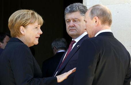 Канцлер Германии Ангела Меркель, президент РФ Владимир Путин и президент Украины Петр Порошенко.