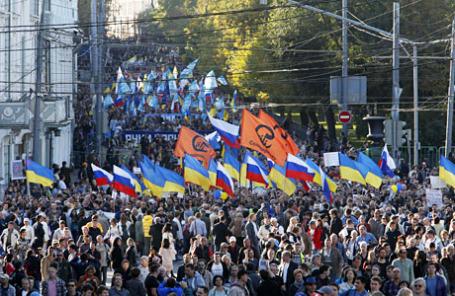 Во время акции «Марш мира» против войны на Украине.