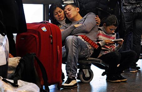 Пассажиры в аэропорту «Шереметьево».