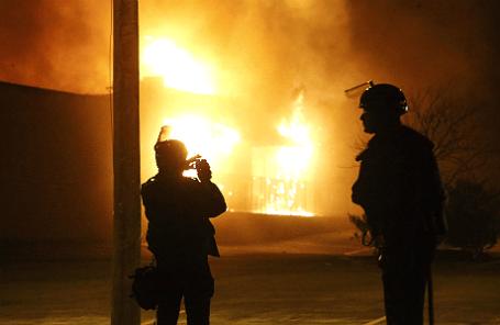 Массовые протесты в Фергюсоне, штате Миссури, повлекшие многочисленные пожары.